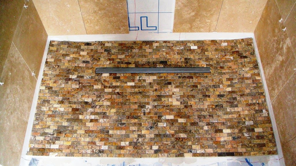 Linear Shower Drains vs. Center Shower Drains